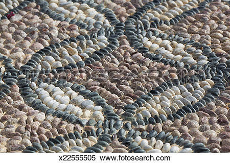 Stock Image of traditional pebble paving in Lindos x22555505.