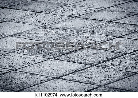 Stock Photo of Rock tiled paved road k11102974.