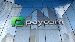 Editorial, Paycom Software Inc. logo on glass building..