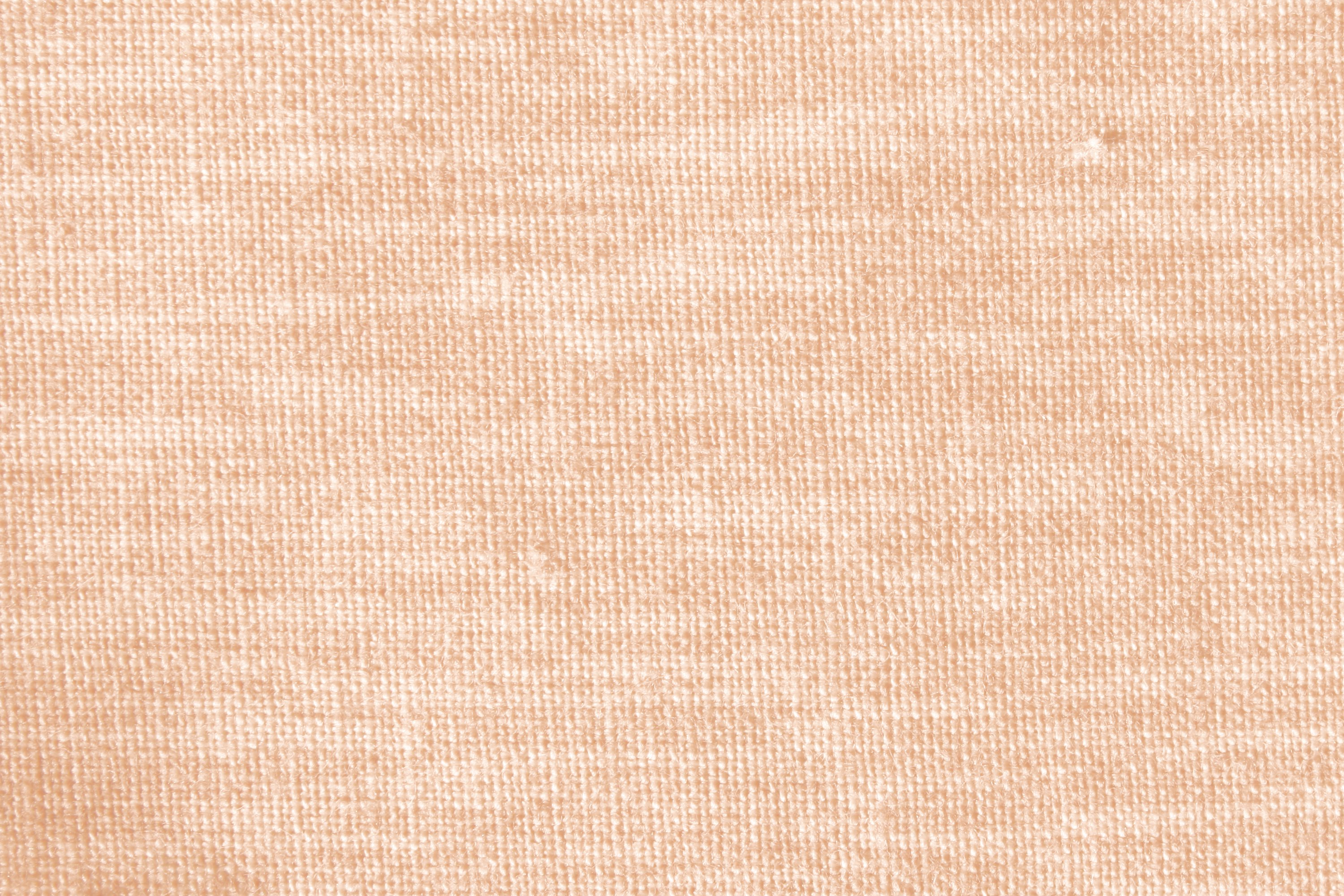 Peach or Light Orange Woven Fabric Close Up Texture Picture.