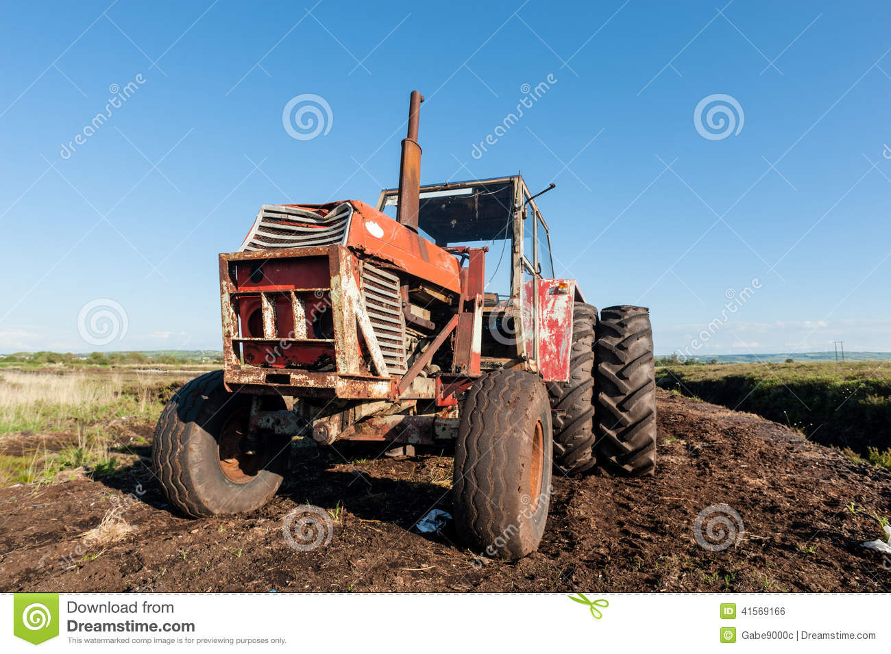 Tractor In A Peat Bog Field Stock Photo.