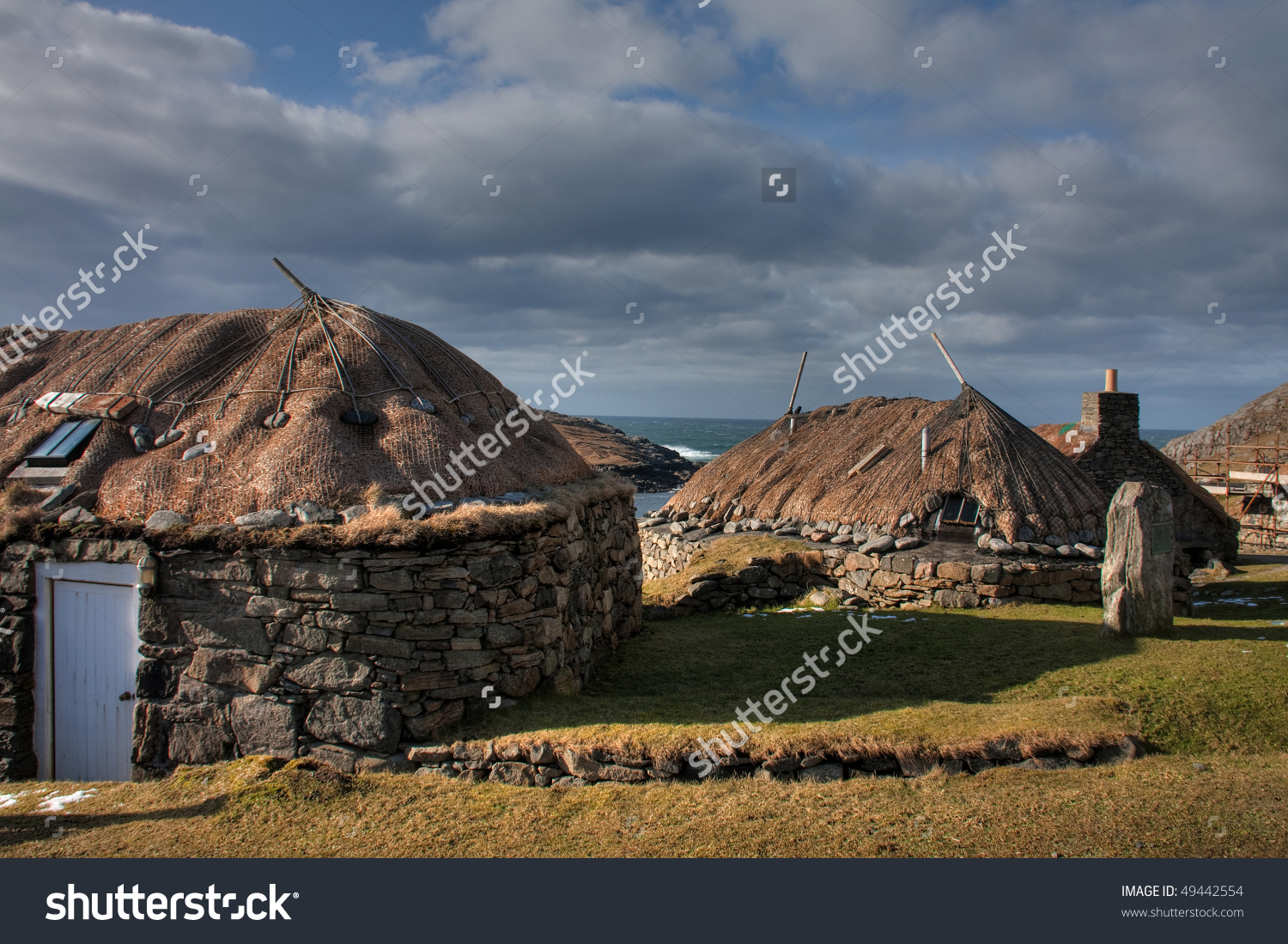 Gearrannan Blackhouse Village With Old Thatched Buildings And Peat.