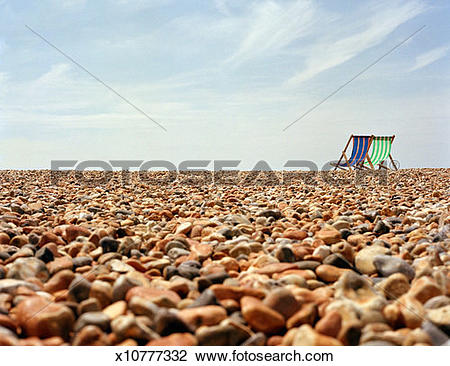 Stock Photo of Two Deck Chairs on Pebble Beach x10777332.