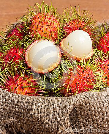 Asian Fruit Peeled Rambutan And Rambutan On Sack Stock Photo.