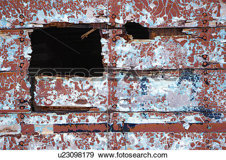 Stock Photograph of Side of wall with hole and peeling paint.
