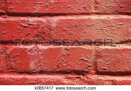 Picture of Red peeling paint on a brick wall k0657417.