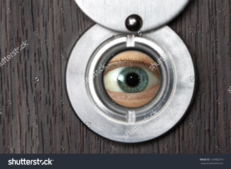 Peephole Eye Closeup On Wooden Door Stock Photo 124485319.