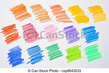 Multi colored pencil strokes on white paper. Isolation of a studio shot..