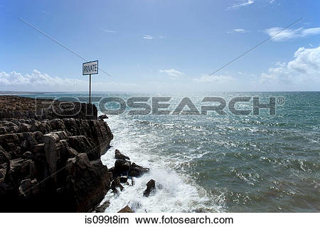 Stock Photo of Private sign on rocks by the sea, Peniche, Portugal.