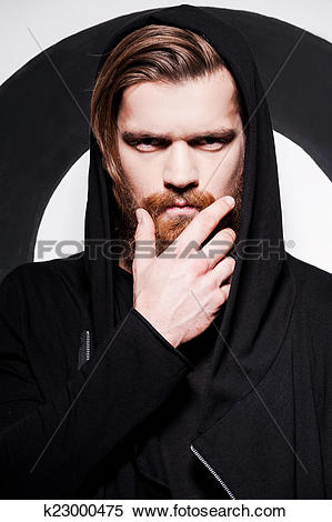 Stock Image of Penetrating glance. Handsome young bearded man.