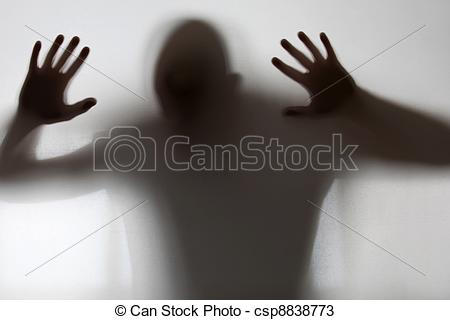 Stock Photos of Shadowy figure trapped behind glass csp8838773.