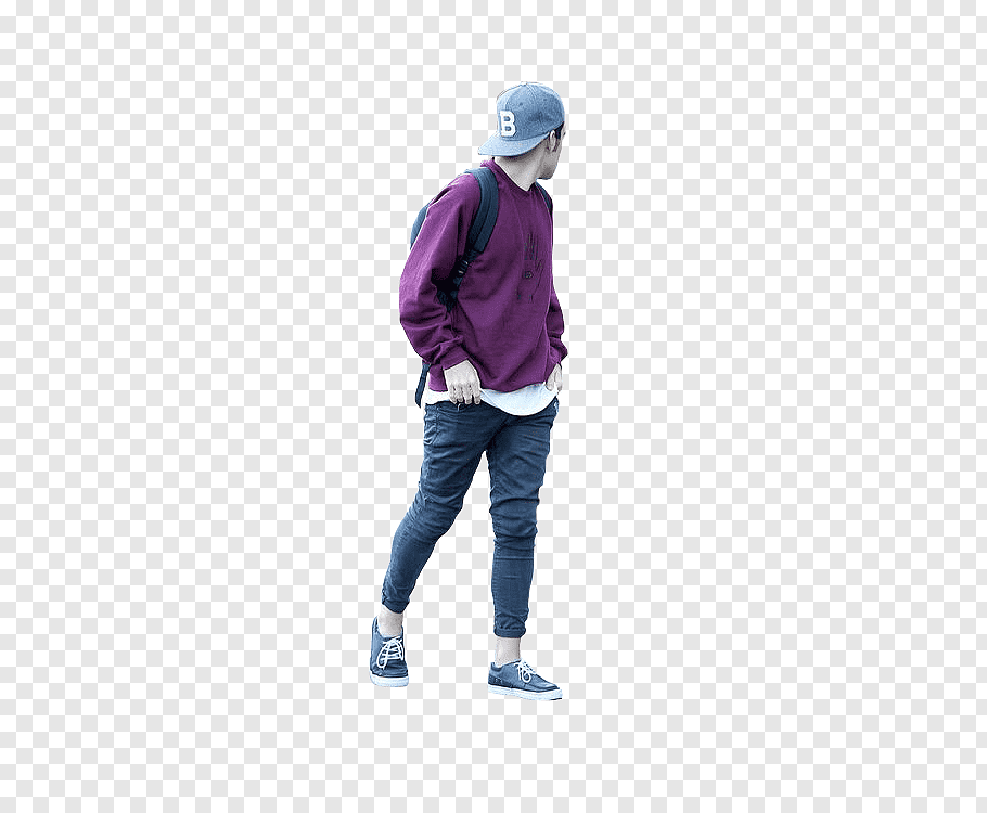 Man wearing purple sweater and blue denim jeans standing.