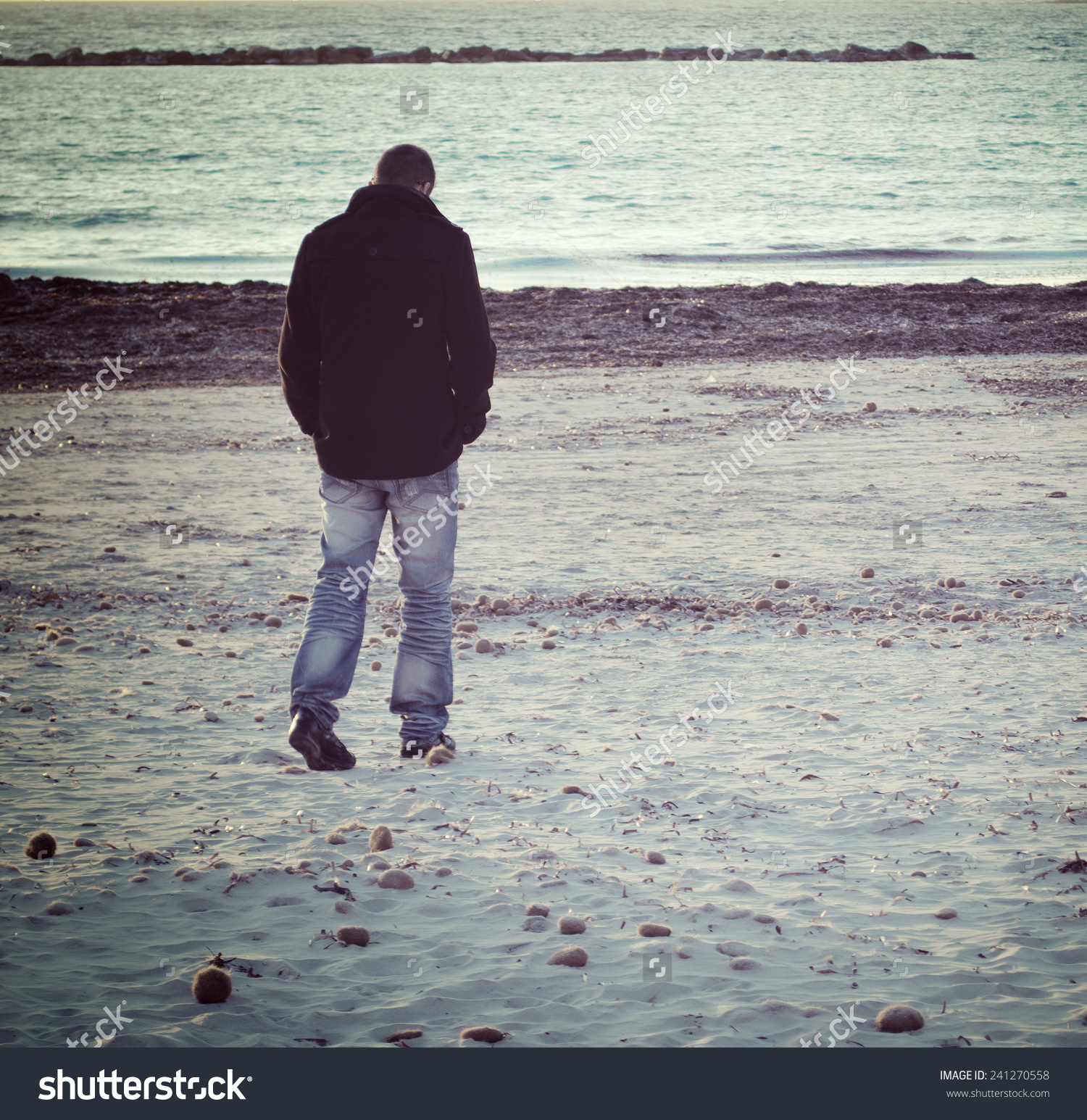 Man Walking Alone By Sea Winter Stock Photo 241270558.