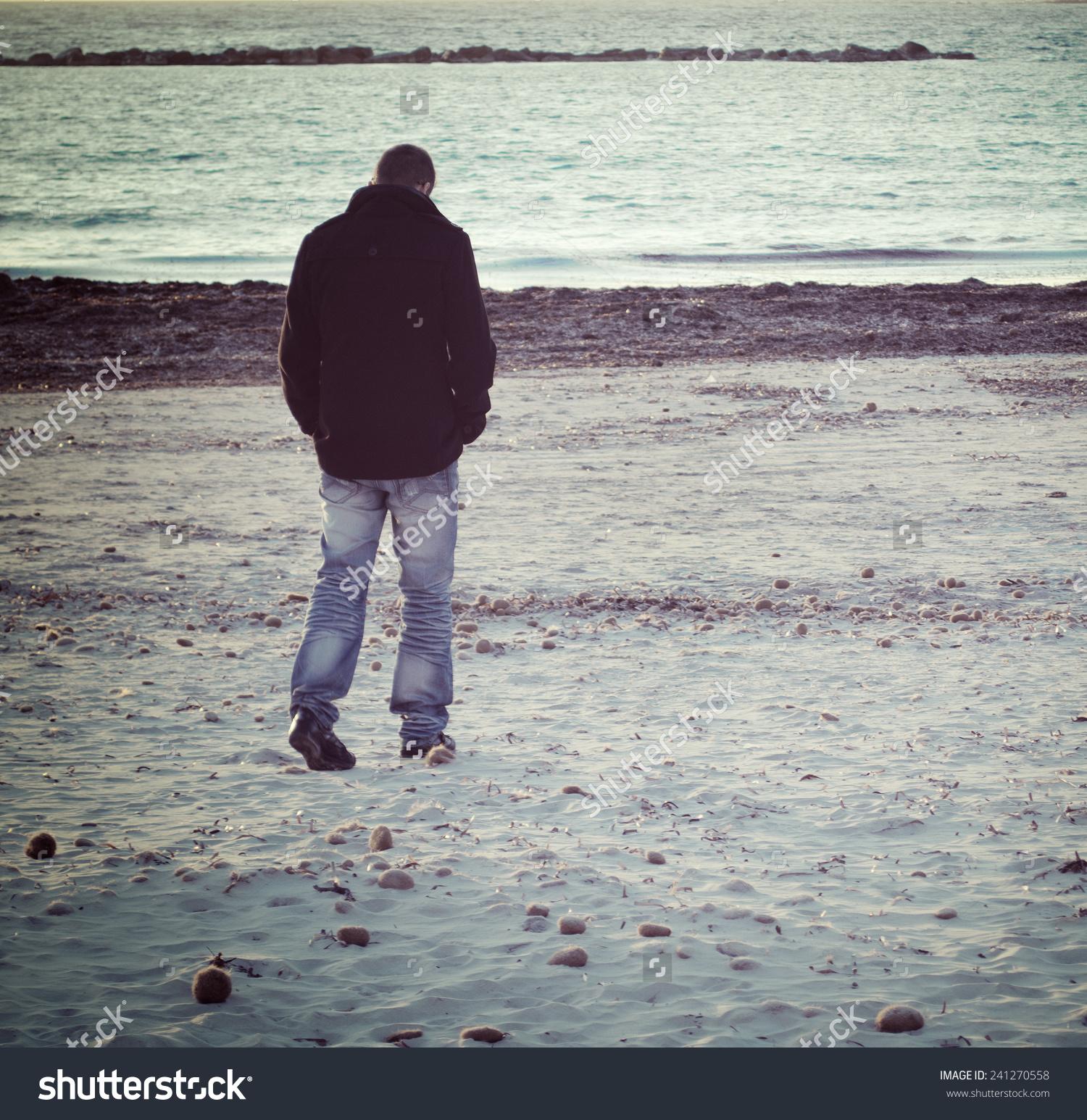 Man Walking Alone By Sea Winter Stock Photo 241270558.