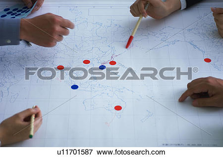 Picture of Business people making plans with map u11701587.