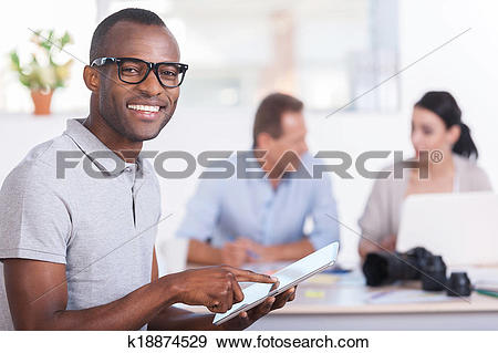 Stock Photograph of Cheerful team leader. Handsome young African.