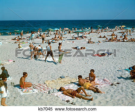 Stock Image of 1960S People On Beach Seaside Heights New Jersey.