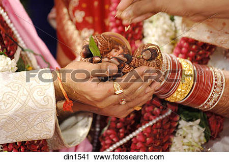 Stock Photography of South Asian Indian bride and bridegroom.