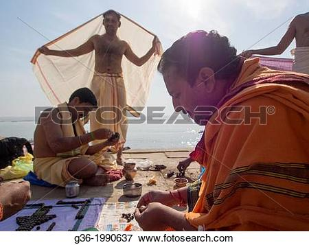 Picture of Indian pilgrims performing rituals at Varanasi, Uttar.
