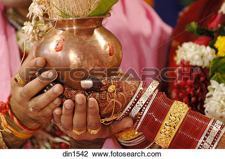 Stock Photo of South Asian Indian bride and bridegroom holding.