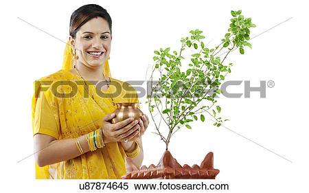 Stock Image of Gujarati woman performing a ritual u87874645.