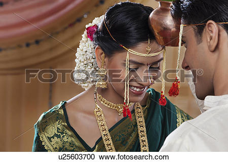 Stock Photography of Maharashtrian bride and groom performing a.