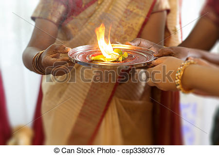 Picture of Indian woman performing special rituals.