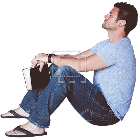 Man Sitting with Book Leaning Against Wall.