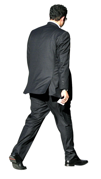 Man in suit walking outside Alex Proimos/CC.