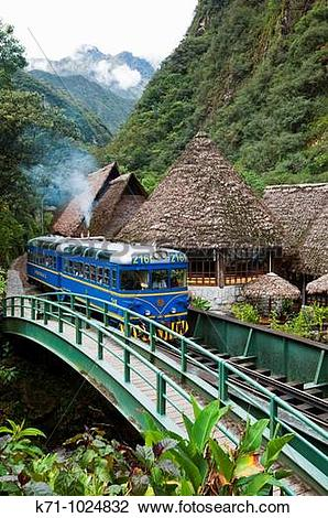 Stock Photo of A Perurail train arriving in the town of Agua.