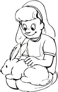 Young Girl Holding a Rabbit and Petting It.