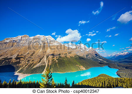 Stock Photo of Mountain Lake is popular among tourists.