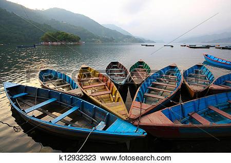 Stock Photo of Colorful boats in Phewa lake, Nepal k12932323.