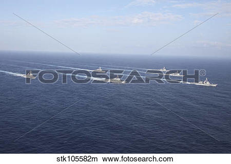 Stock Photo of Military ships transit the Philippine Sea in.