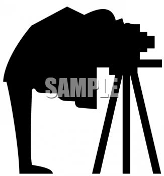 Silhouette of a Photographer Under a Drop Cloth Taking a Picture.
