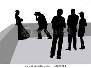 Picture: Silhouettes of People Watching a Photoshoot.