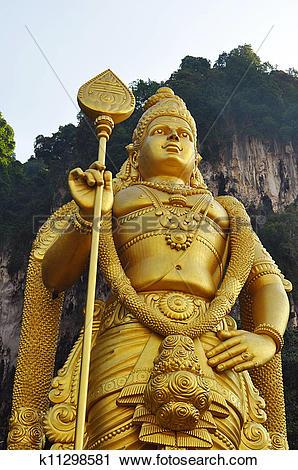 Stock Photography of Lord Murugan statue at the hindu Batu caves.