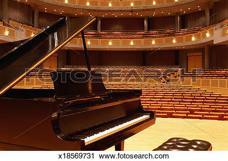 Stock Photography of Interior of theater, empty seating, piano on.