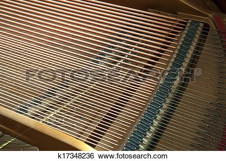 Stock Images of Closeup of grand piano showing the strings, pegs.