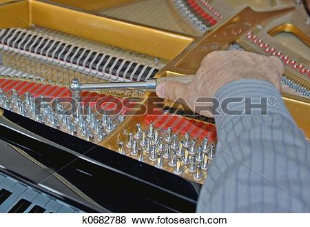 Pictures of tuning piano strings k0682788.