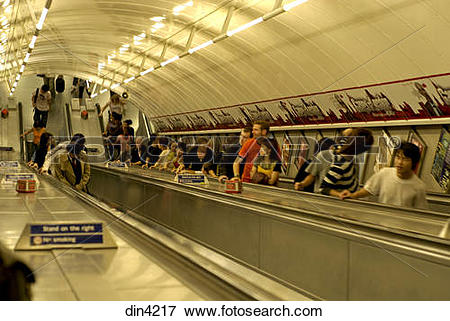 Picture of Tube station ; passengers on escalators ; Piccadilly.