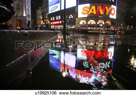 Stock Images of England, London, Piccadilly Circus. Rainy neon.