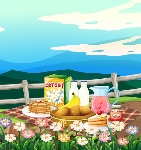 Scene with breakfast set on picnic cloth.
