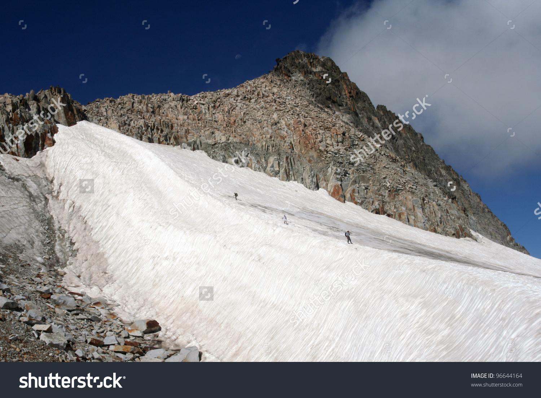 Climbing Pico De Aneto In Aneto Glacier, Pyrenees, Spain Stock.