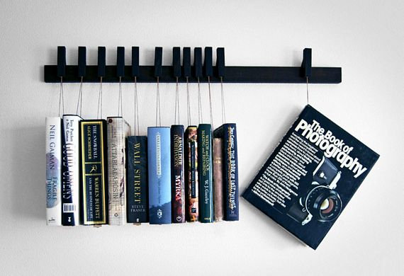 This Unique Book Rack Hangs Your Books On The Wall.