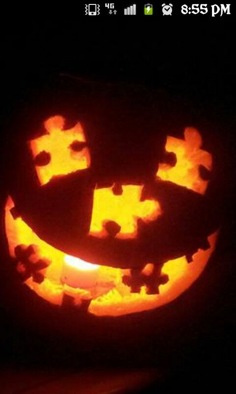 Pumpkin made of puzzle pieces clipart.