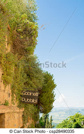 Stock Photos of Sign of public toilets in Pienza, Siena in Tuscany.