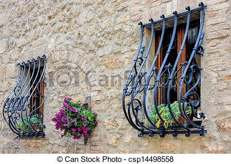 Stock Images of Wrought iron security bars over windows in Pienza.