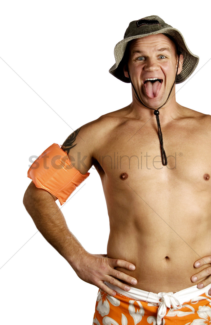 Shirtless man sticking out his tongue Stock Photo.