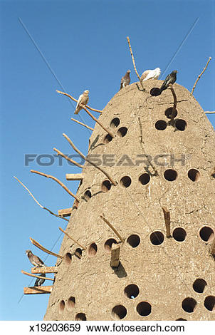 Stock Photograph of Traditional Egyptian pigeon house against.